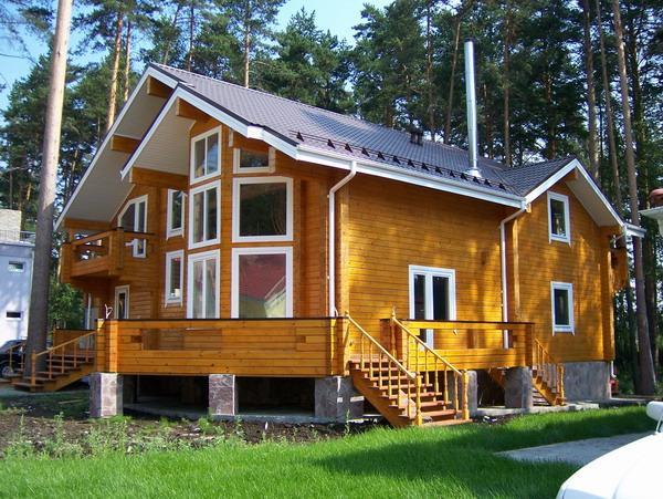 Как выгодно построить дом из клееного бруса